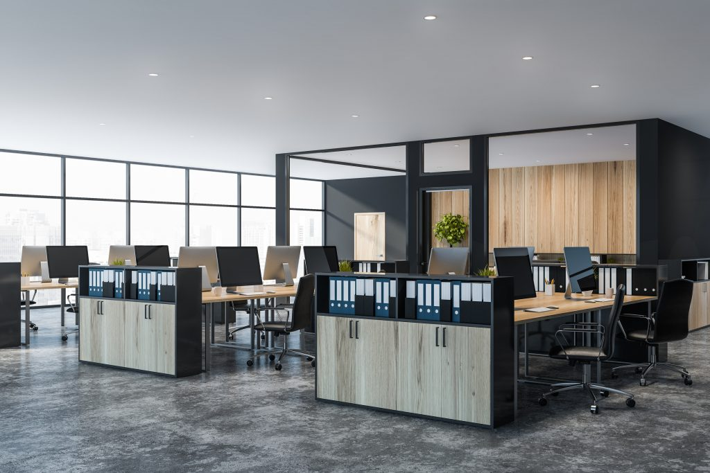 Clean modern office space with desks and concrete floors