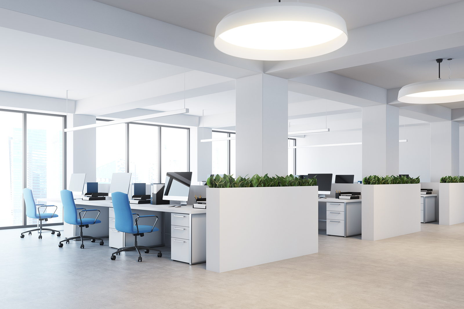 White office space inside commercial building with concrete floors