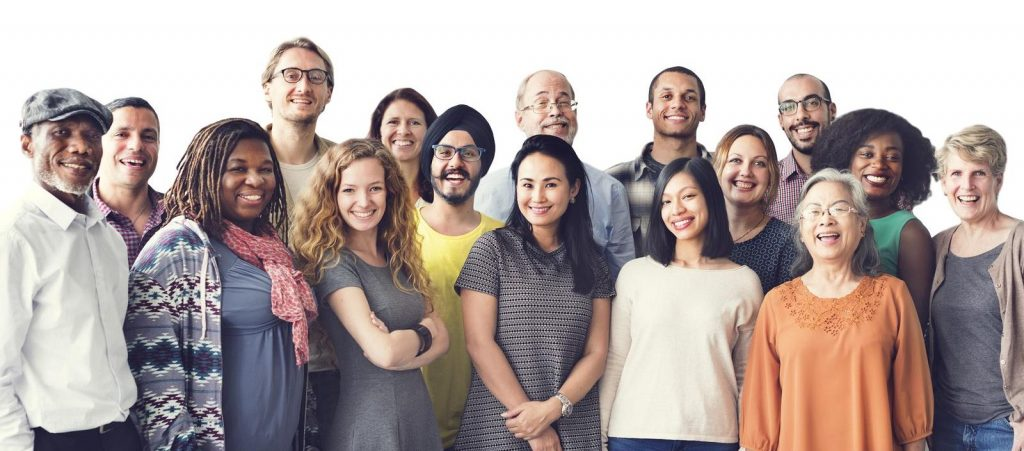 Diverse employee group embracing team union