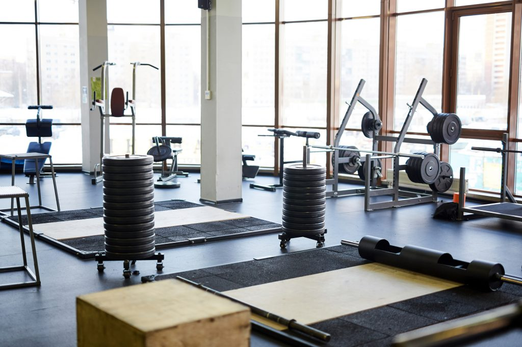 Group of special sports equipment for cross training in a clean gym of contemporary fitness center
