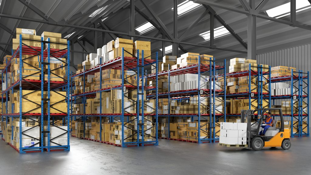 Warehouse worker with forklift in clean industrial facility with concrete floors