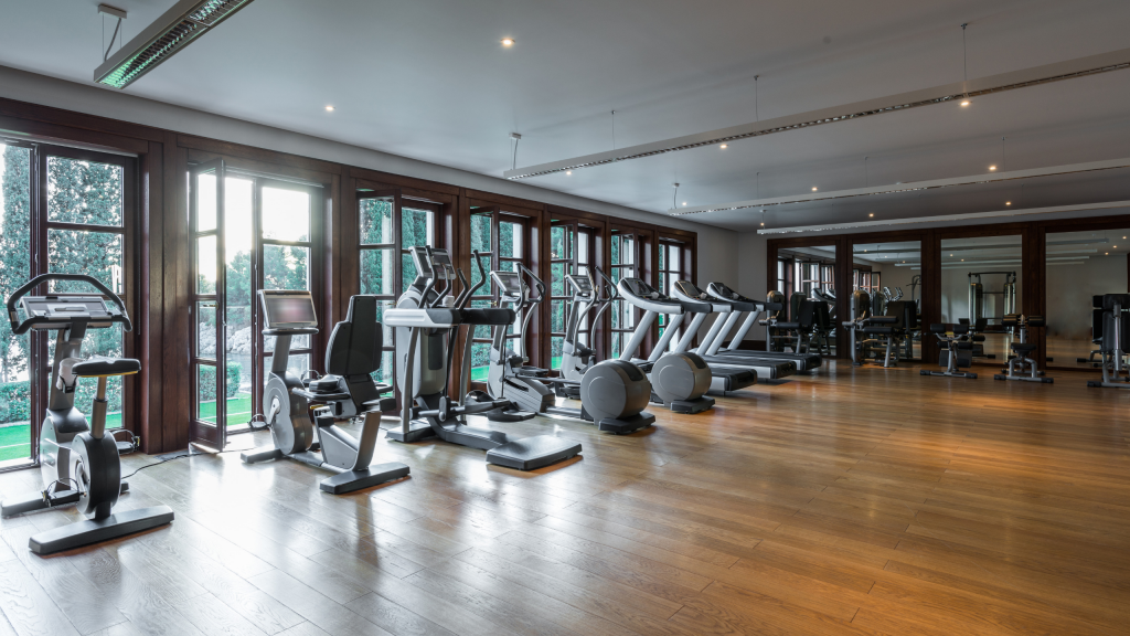 Cycling studio in a fitness center with clean hard wood floors