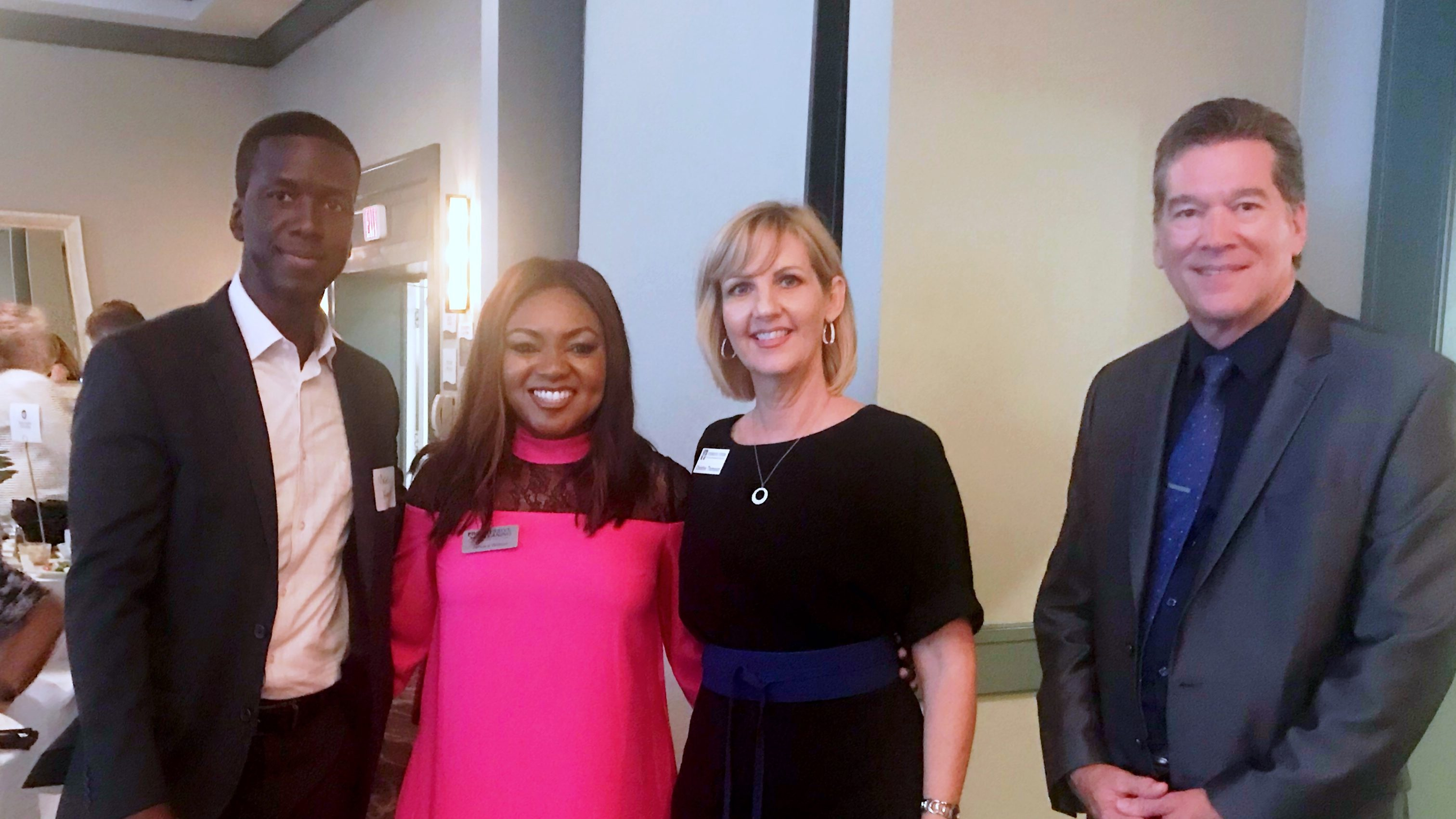 Moses Harvin II and Jamara Wilson of Progressive Cleaning with Christine Thompson of Carr, Riggs and Ingram and Eric McKinney of Space Coast Business Magazine