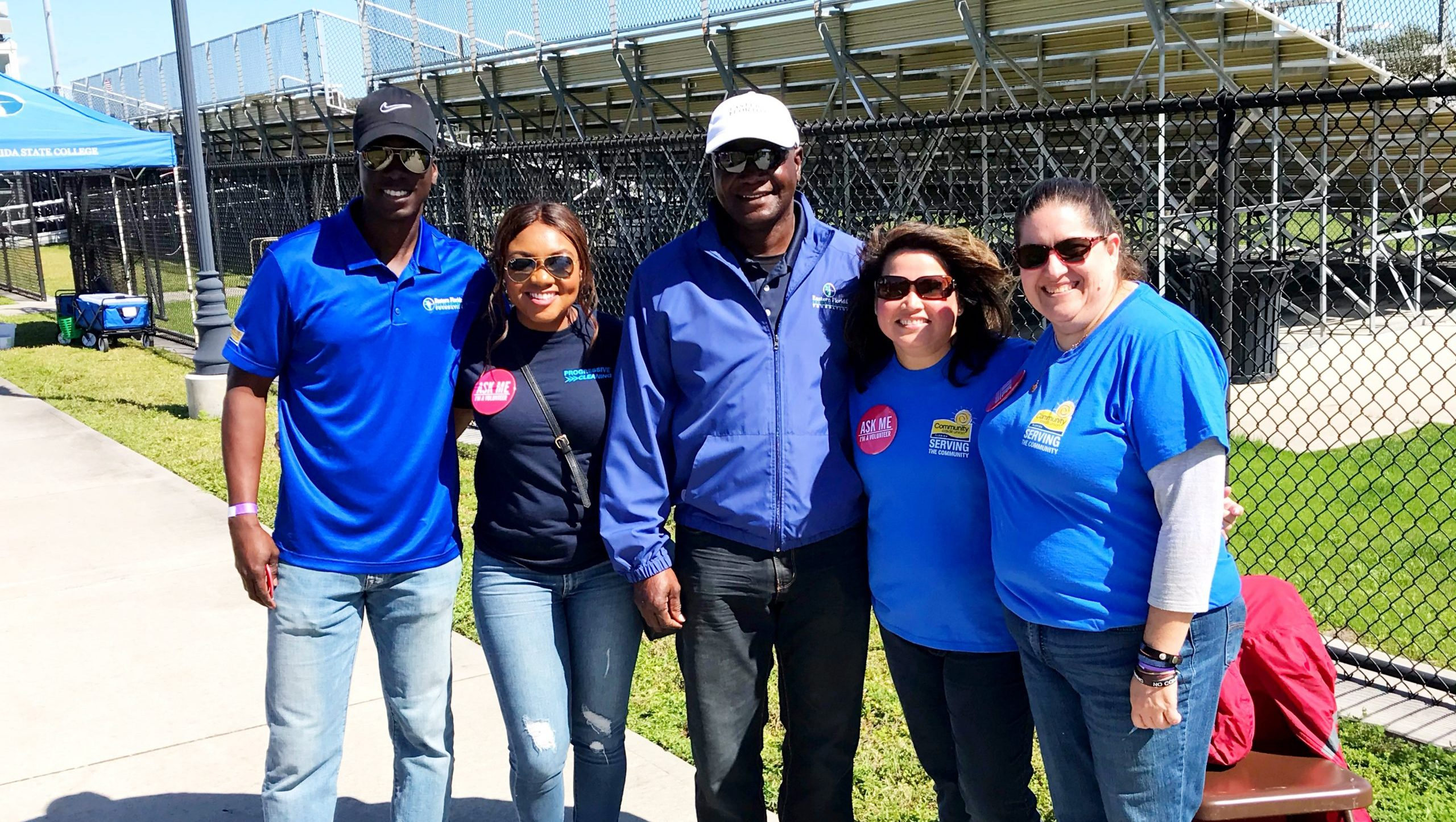moses harvin ii and jamara wilson of progressive cleaning with volunteers of community credit union and board member of efsc