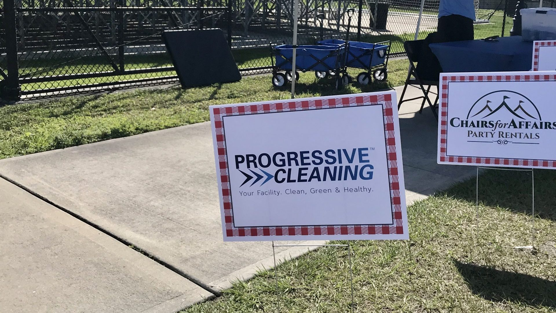 progressive cleaning pit sponsor sign at efsc annual backyard bbq